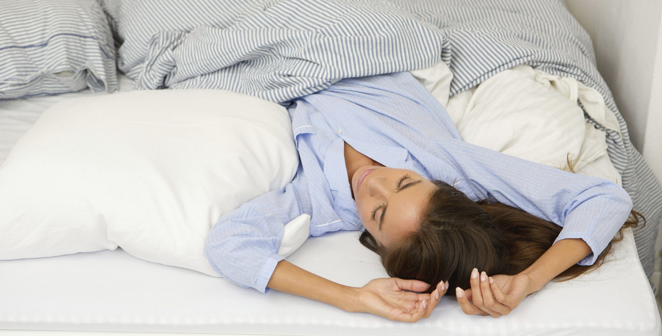 woman-sleeping-bed-back